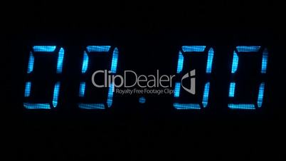 Digital clock with fluorescent display shows 00:00 in blue color