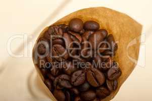 espresso coffee beans on a paper cone