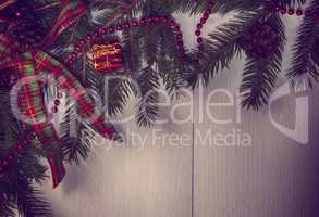 Vintage Christmas background with decorated branches of spruce
