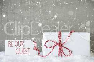 Gift, Cement Background With Snowflakes, Text Be Our Guest