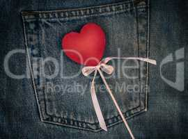 Wooden figure of heart on the background of the back pocket of b