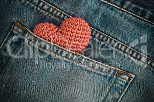Small knitted heart in the back pocket of jeans