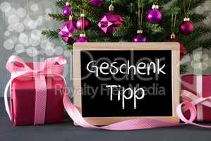 Tree With Gifts, Bokeh, Text Geschenk Tipp Means Gift Tip