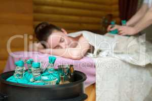 Beauty and health. Thai massage with salt bags