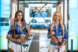 Car wash. Sexy girls posing with pressure washers