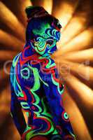 Clubbing. Image of nude girl with luminous bodyart