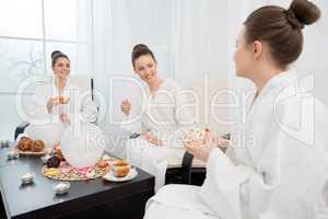 Tea drinking in spa salon. Photo of lovely ladies