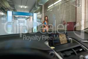 View from inside of car on sexy girl with washer