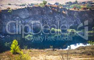 deep unused stone quarry and the river