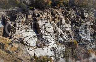 stone wall of deep unused stone quarry