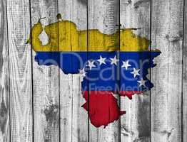 Karte und Fahne von Venezuela auf verwittertem Holz