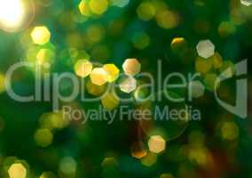 Green background with yellow bokeh, blurred background