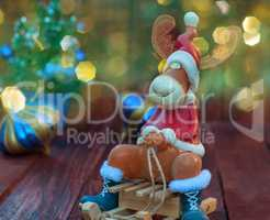 Reindeer on winter wooden sled, blurred bokeh background with mu