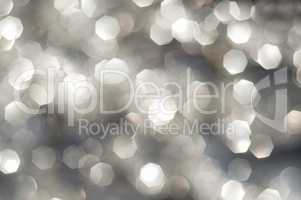 silver and white bokeh lights defocused