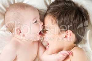 Mixed Race Chinese and Caucasian Baby Brothers Having Fun Laying