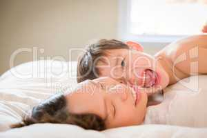 Mixed Race Chinese and Caucasian Boy Laying In His Bed with His
