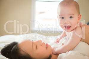 Mixed Race Chinese and Caucasian Baby Boy Laying In Bed with His
