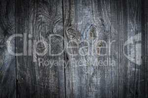 Gray old wooden background with knots and cracks