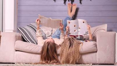 Mother and daughter reading magazines together