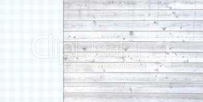 Helle Holzbretter mit Tischdecke blau weiß