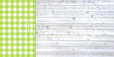 Helle Holzbretter mit Tischdecke grün weiß