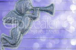 Figure angel of shiny particles on a  purple background