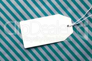 Label On Turquoise Wrapping Paper And Copy Space