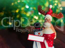 Christmas Elk with a snowman standing on a blurred background