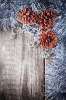 Home decor pine cones on a wooden background
