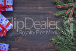 Brown wood background with festive decorations, empty space in t