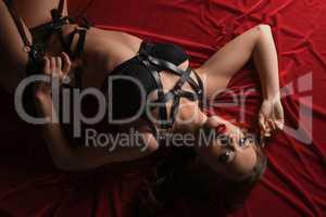 Erotica. Top view of sensual girl lying in bed