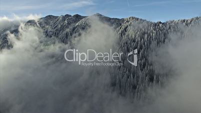 Aerial Drone Flying over Clouds and Mountains