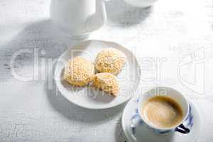 Almond cookies and coffee on white table