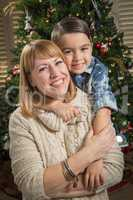 Mother and Mixed Race Son Hug Near Christmas Tree