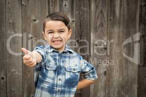 Young Mixed Race Boy Making Hand Gestures