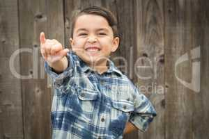 Young Mixed Race Boy Making Shaka Hand Gesture