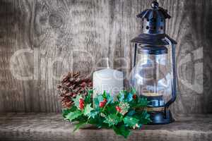 Christmas ornaments and candle light on rustic wood