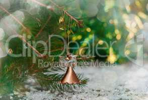 Celebratory background with Christmas toy hanging on fir branch