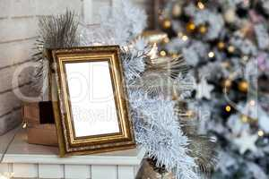 Photo frame in christmas decorated background
