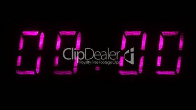 Digital clock with fluorescent display shows 00:00 in multi color