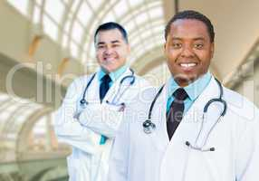African American and Caucasian Male Doctors Inside Hospital