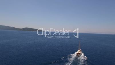 Amazing view to Yacht sailing in open sea at sunny day. Drone shotting view