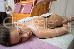 Spa massage. Young girl lying on her stomach