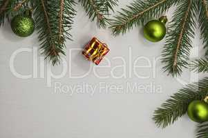 white wooden background with branches of spruce and Christmas de