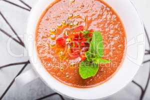 Bowl of Fresh tomato soup Gazpacho in white plate