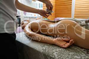 Young brunette lying on her stomach in sap salon
