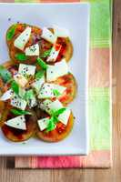 Tomato salad with melon, cheese, basil, sesame