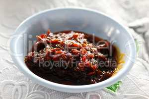 Thai Red Curry Paste in white dish.