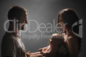 Young family and newborn baby studio shot