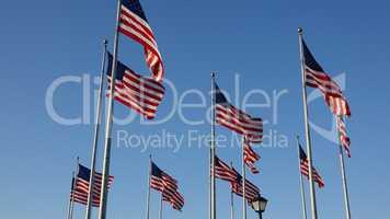 American Flags Waving On Flagpoles